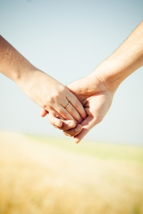 American Income Life - holding hands